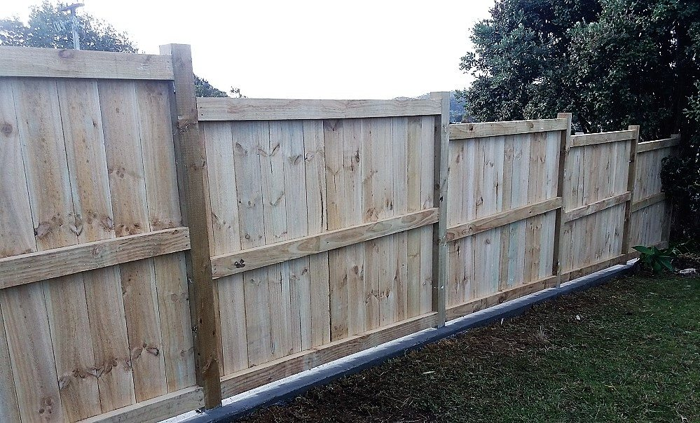 Timber fence with mowing strip