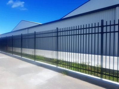 Security fence with mowing strip